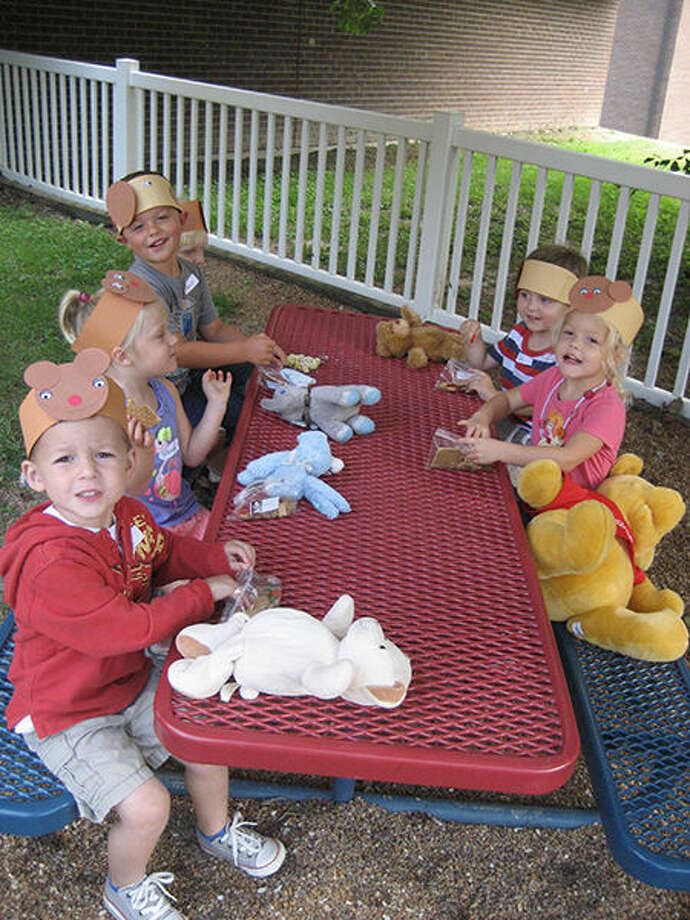 Youngsters take part in an outdoor activity during a YMCA preschool session.