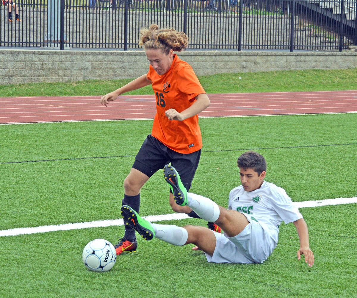 Edwardsville's Josh Reed works around a downed St. May's defender in the first half.
