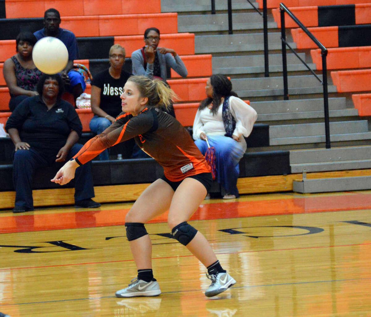Edwardsville defensive specialist Nicki Meyer successfully receives a serve.