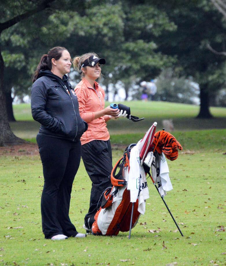 Edwardsville coach Abby Comerford talks to EHS junior Paige Hamel on the ninth hole at Oak Brook Golf Club.
