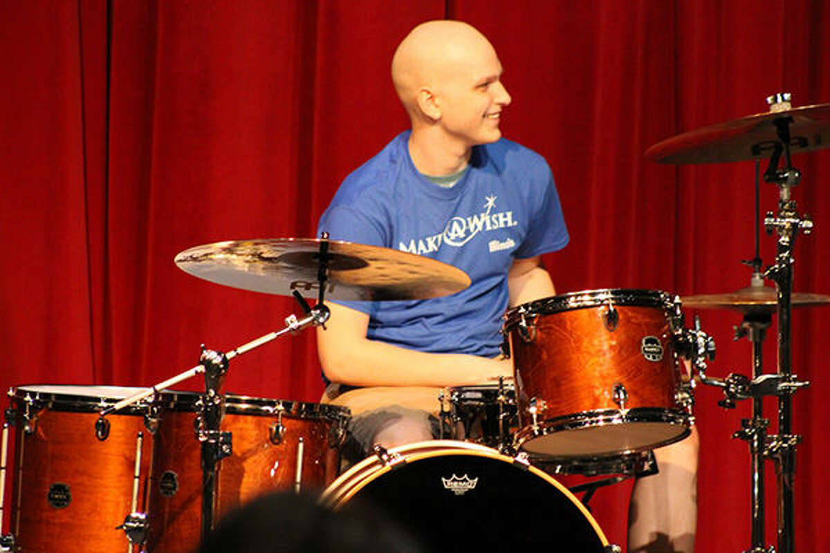 Oliver Knapp plays the drums on his new kit as part of a Make-A-Wish dream come true.