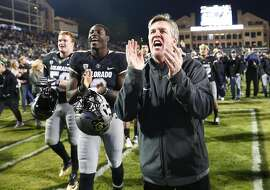 Colorado Buffaloes head coach Mike MacIntyre sings the school song with players in the second half of an NCAA college football game Saturday, Nov. 19, 2016, in Boulder, Colo. Colorado won 38-24. (AP Photo/David Zalubowski)