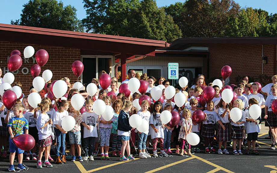 St. Mary's students prepare to launch balloons as part of the school's 50th anniversary celebration.