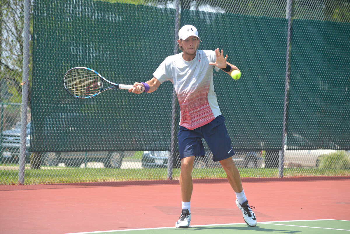 Strong Kircheimer hits a forehand during his title match against Olukayode Ayeni on Thursday at the Pro Wild Card Challenge.