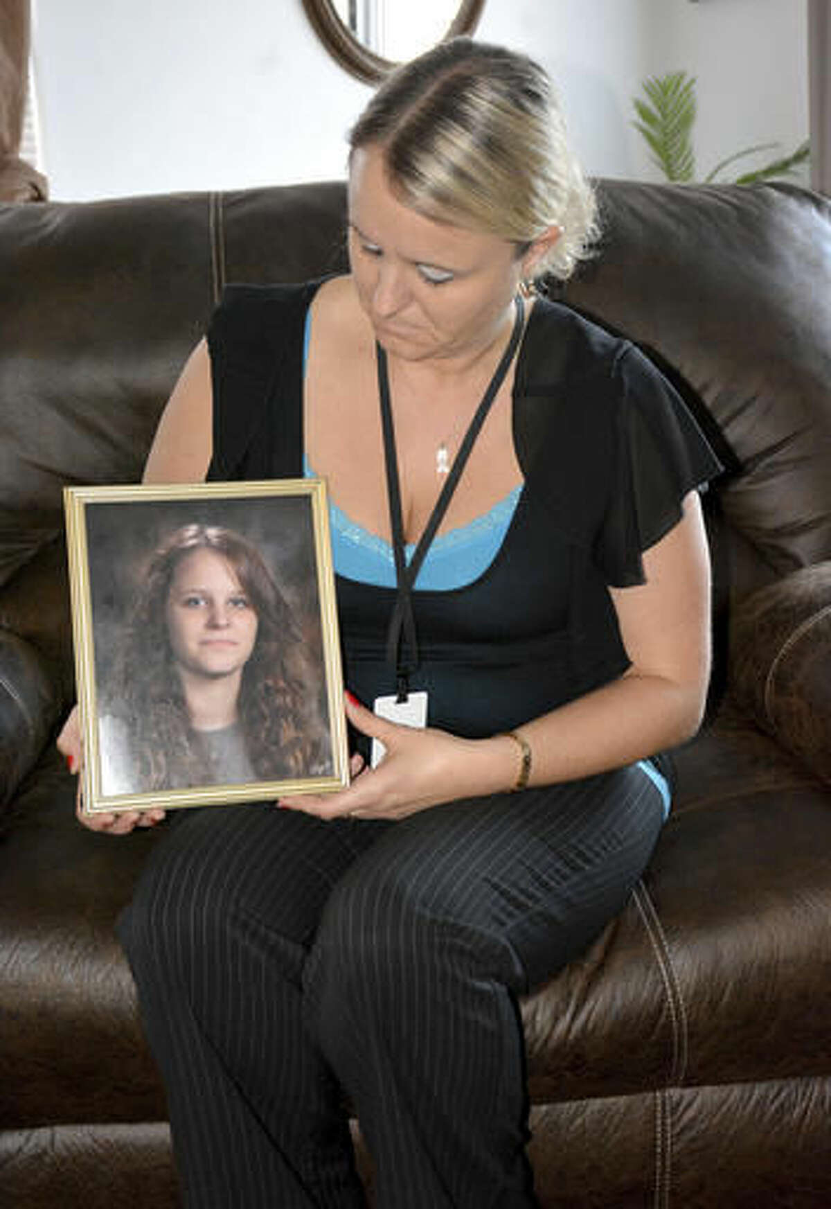 In this Oct. 13, 2016 photo, Crystal Gonzalez holds a picture of her daughter, Kaylee Jacob, at her home in Effingham, Ill. Jacob was 16 when a teenage friend messing around with a gun in the backseat of a car parked in Effingham, Ill., accidentally shot her to death in 2015. Nearly a year later, the girl's mother said the pain still lingers,and she knows that it always will.