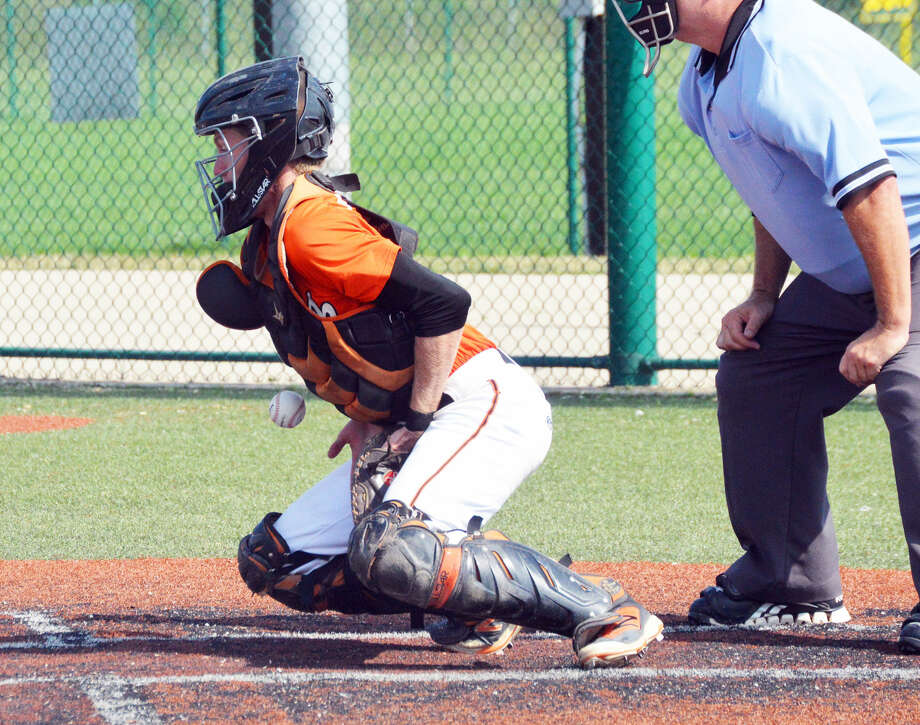 Edwardsville catcher Will Messer successfully blocks a pitch during a game this summer at the junior varsity field.