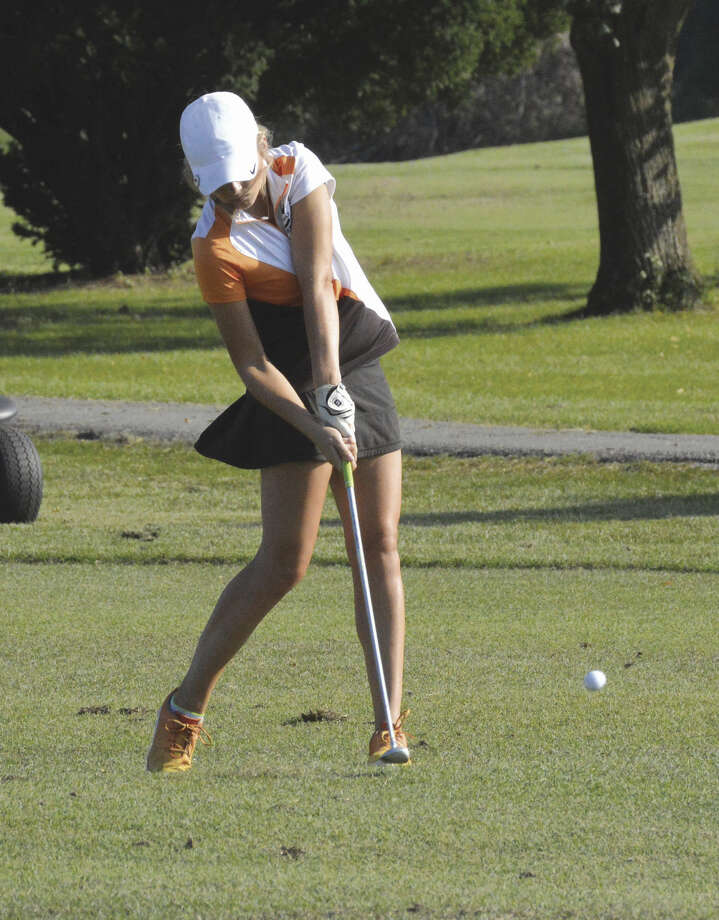 Addy Zeller hits her second shot on the par-5 ninth hole at Clinton Hill in Swansea.