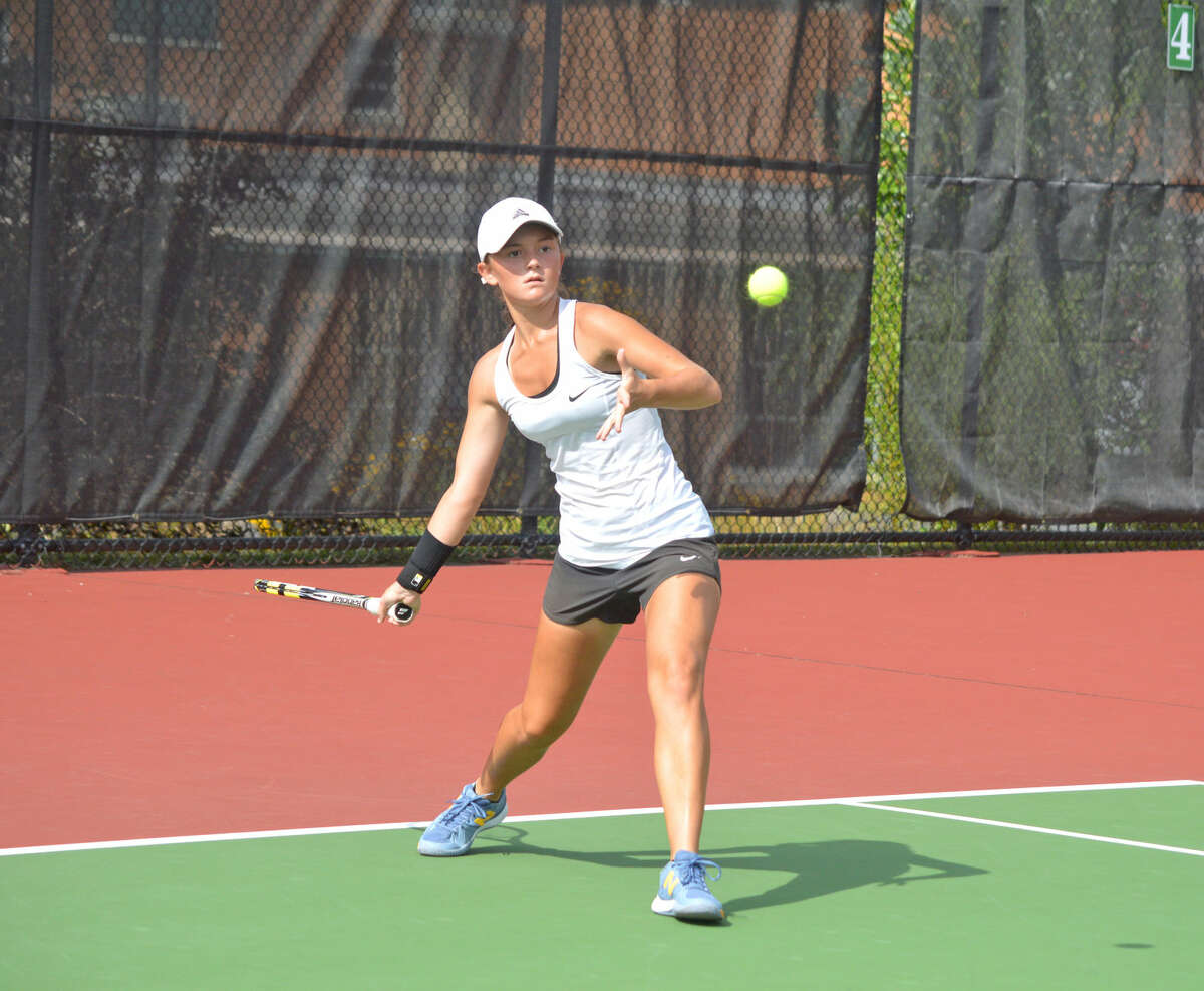 Edwardsville junior Grace Desse returns a shot during her No. 1 doubles match with partner Morgan Colbert on Thursday at St. Joseph's Academy.