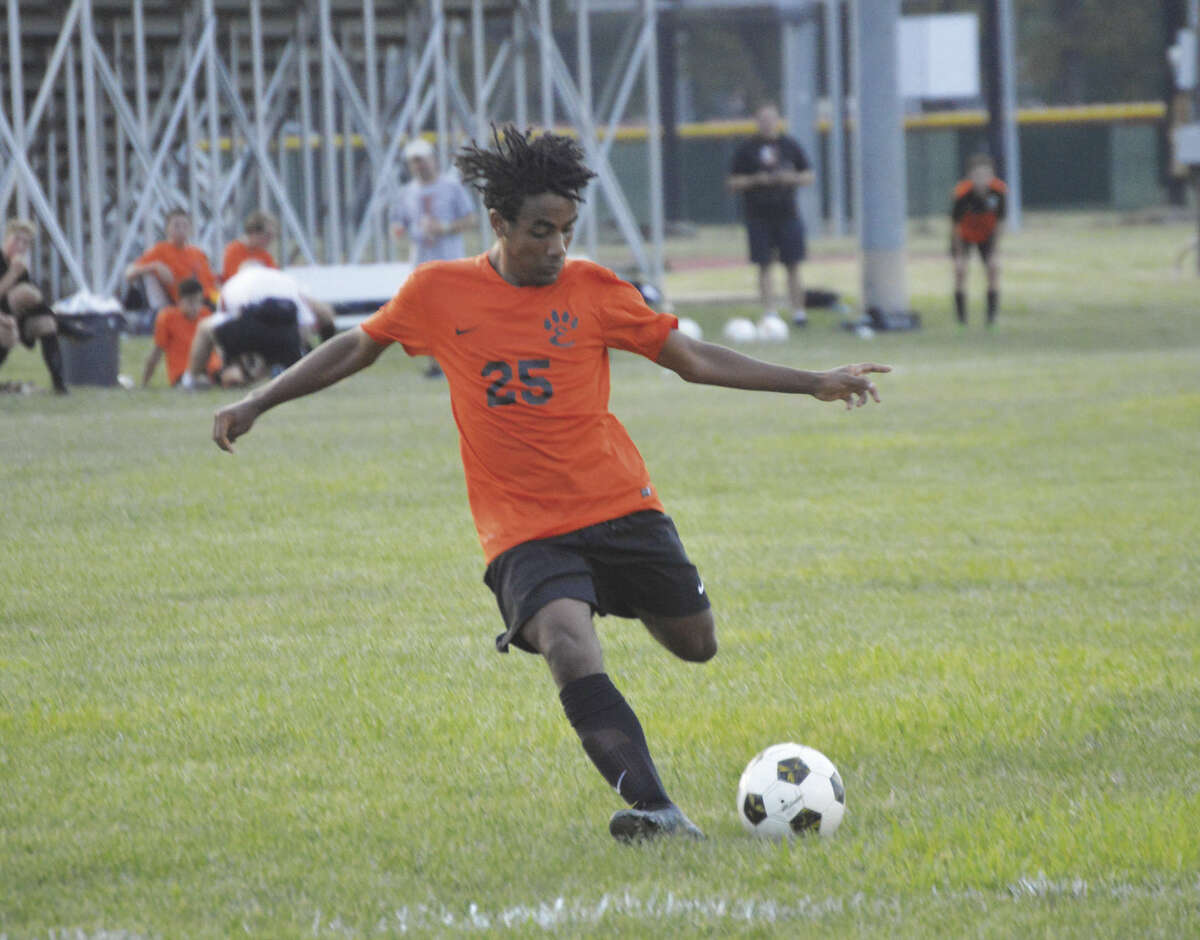 Edwardsville junior midfielder Hanu Freese unleashes a left-footed shot in the first half.