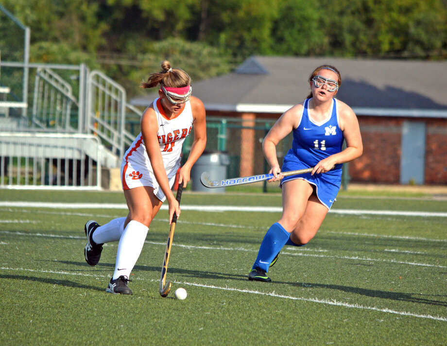 Edwardsville junior Natalie Nava, left, tries to get past Marquette's Cayli Shinstock during Thursday's game at EHS.