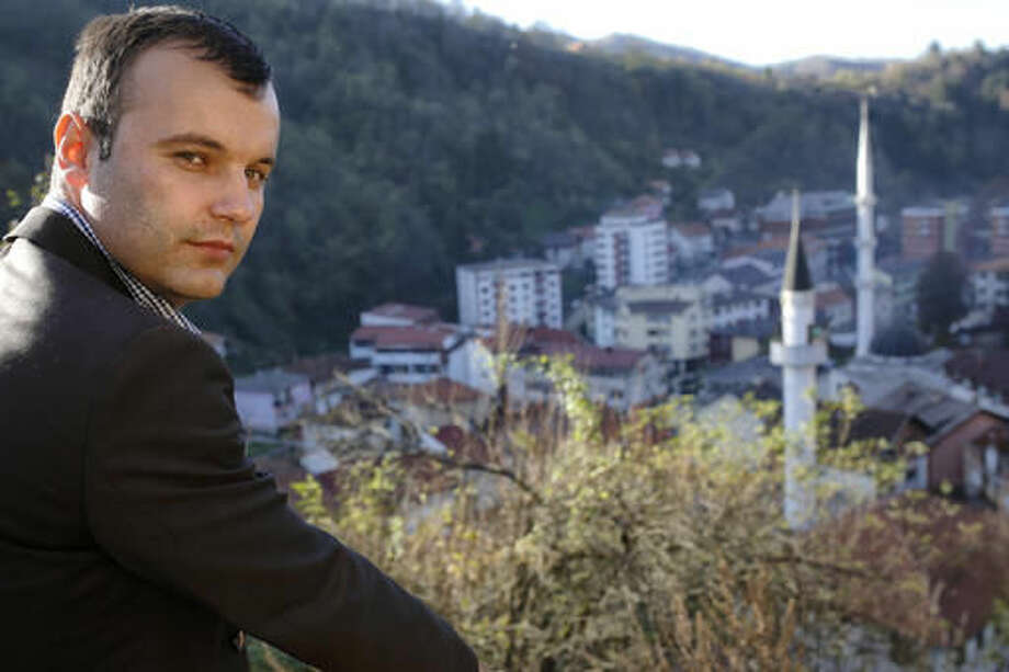 In this photo taken on Tuesday, Nov. 1, 2016, newly elected mayor of Srebrenica, Bosnian Serb Mladen Grujicic poses for a photo in the eastern Bosnian town of Srebrenica, 250 kms east of Sarajevo. For the first time since the Bosnian war of the 1990s, an ethnic Serb, Mladen Grujicic, has been elected as mayor of the Bosnian town whose name is synonymous with slaughter of more than 8,000 Bosnian Muslims. (AP Photo/Amel Emric)