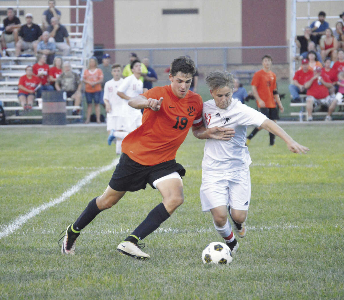 Edwardsville senior Michael Picchiotti tries to keep a Granite City defender away from the ball at midfield during the first half at Gene Baker Field.