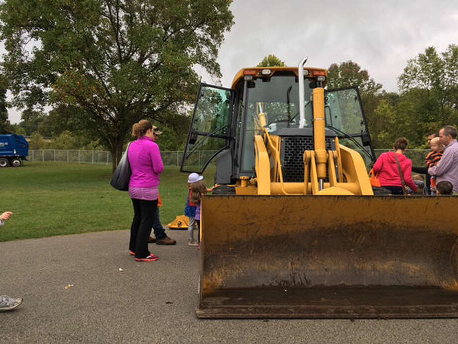 A crowd gathers to look at a front-loader Saturday at the Touch-A-Truck event at Edwardsville Township Park.