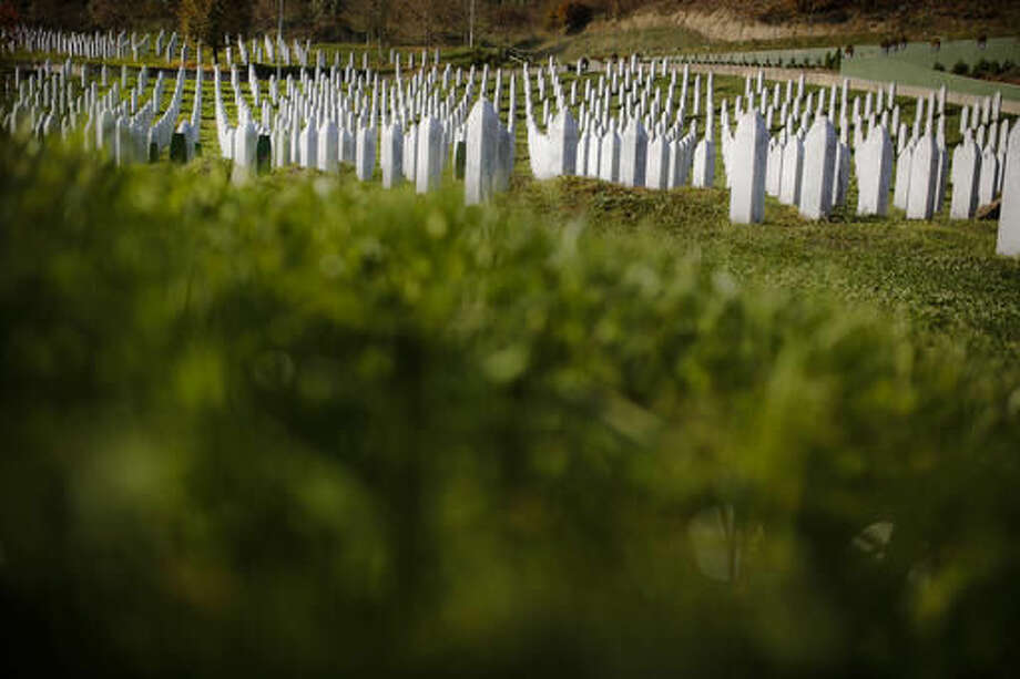 This photo taken on Tuesday, Nov. 1, 2016, shows gravestones of Bosnian Muslims killed during the fall of the Bosnian town of the Srebrenica massacre in the memorial cemetery of Potocari, near Srebrenica, 250 kms east of Sarajevo. For the first time since the Bosnian war of the 1990s, a Bosnian Serb, Mladen Grujicic, has been elected as mayor of the Bosnian town whose name is synonymous with slaughter of more than 8,000 Bosnian Muslims. (AP Photo/Amel Emric)
