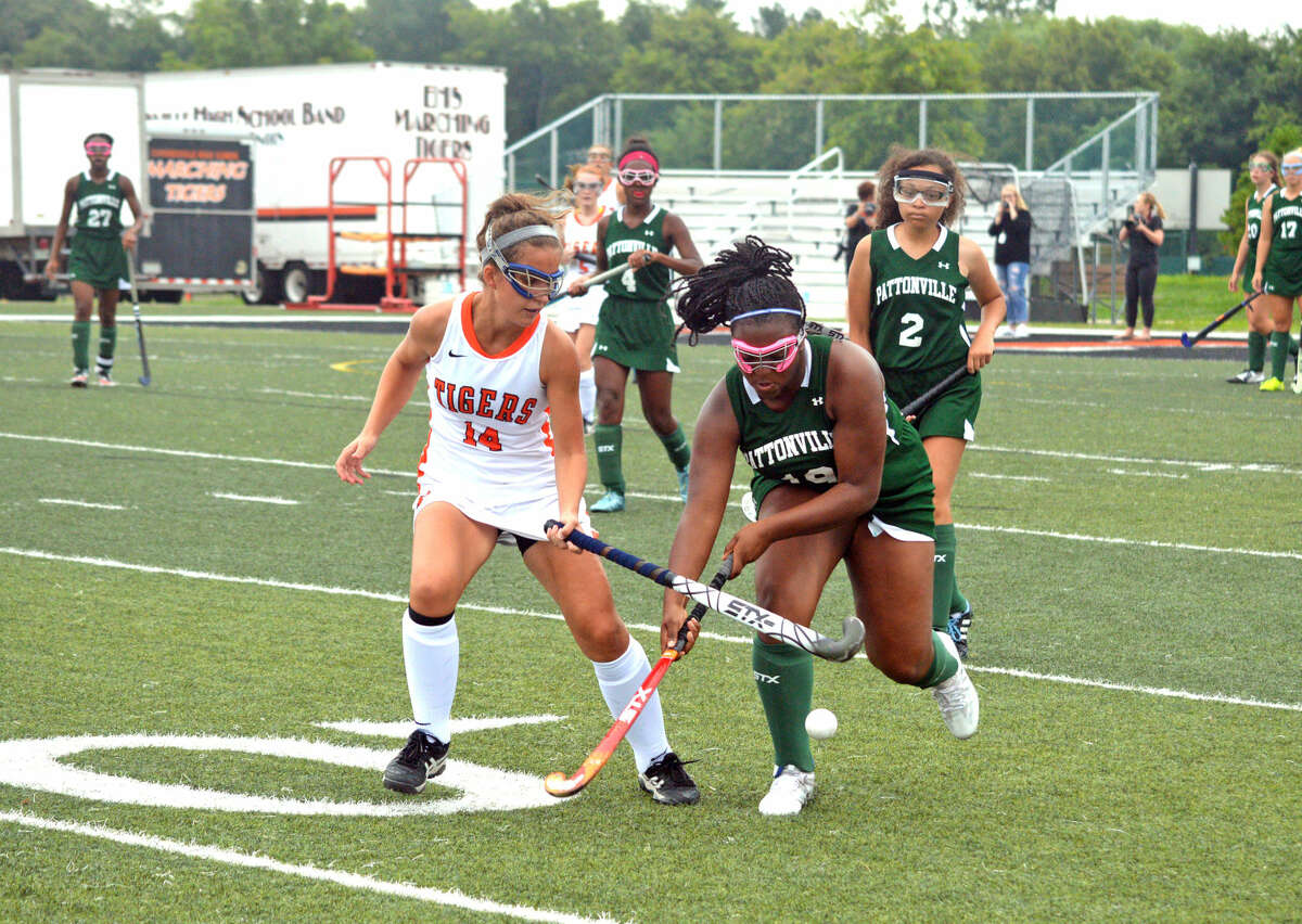 Edwardsville senior Jade Weber, left, tries to get the ball away from Pattonville's Sierra Jones during Tuesday's game at EHS.