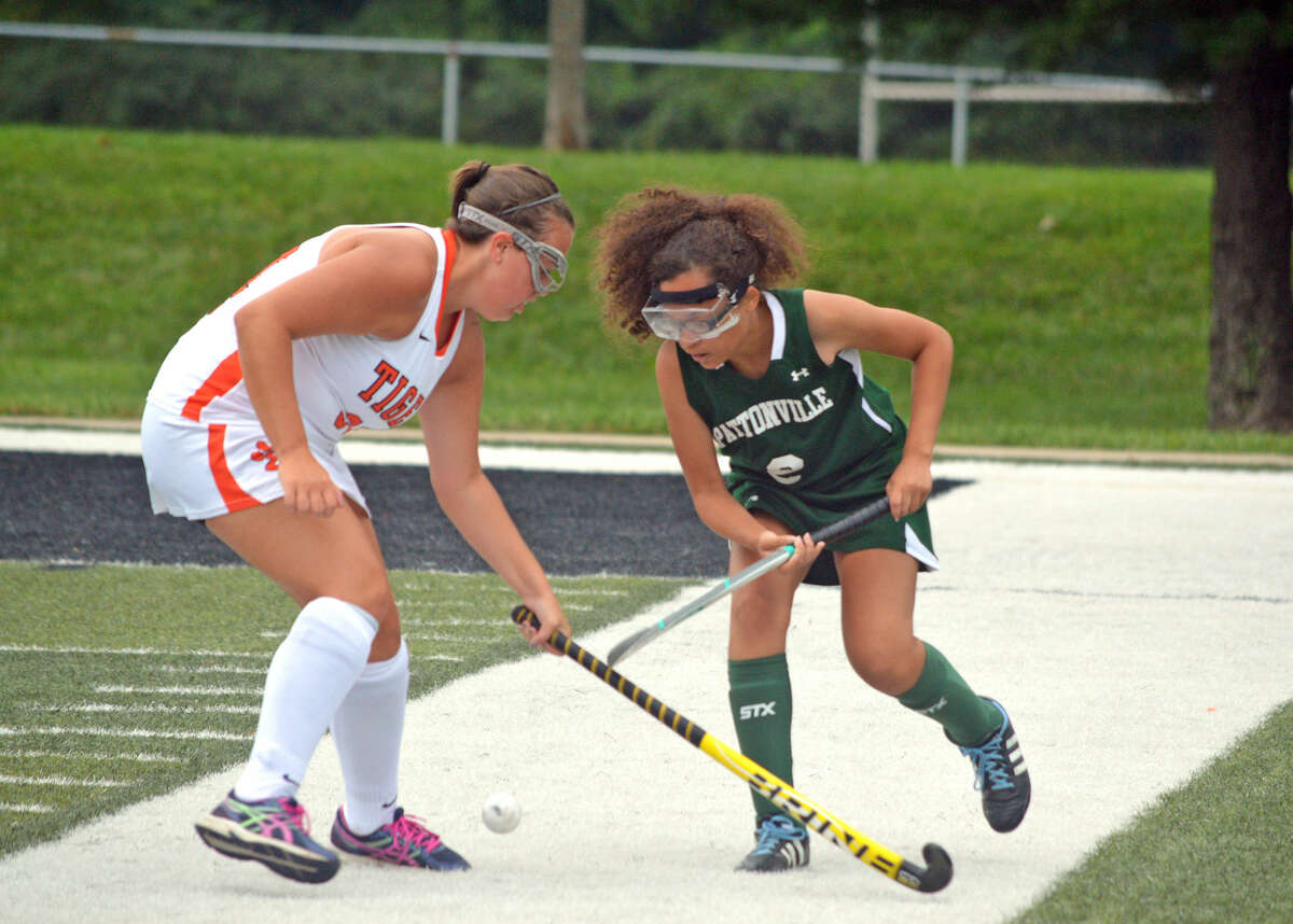 Edwardsville senior Rylie Murray, left, battles for the ball with a Pattonville player during Tuesday's game at EHS.