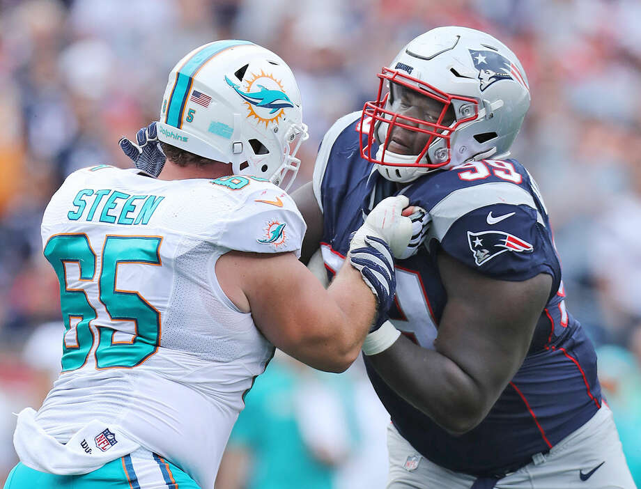 New England defensive tackle Vincent Valentine, left, works against Miami offensive lineman Anthony Steen during a Week 2 game. Valentine is an Edwardsville High School graduate.