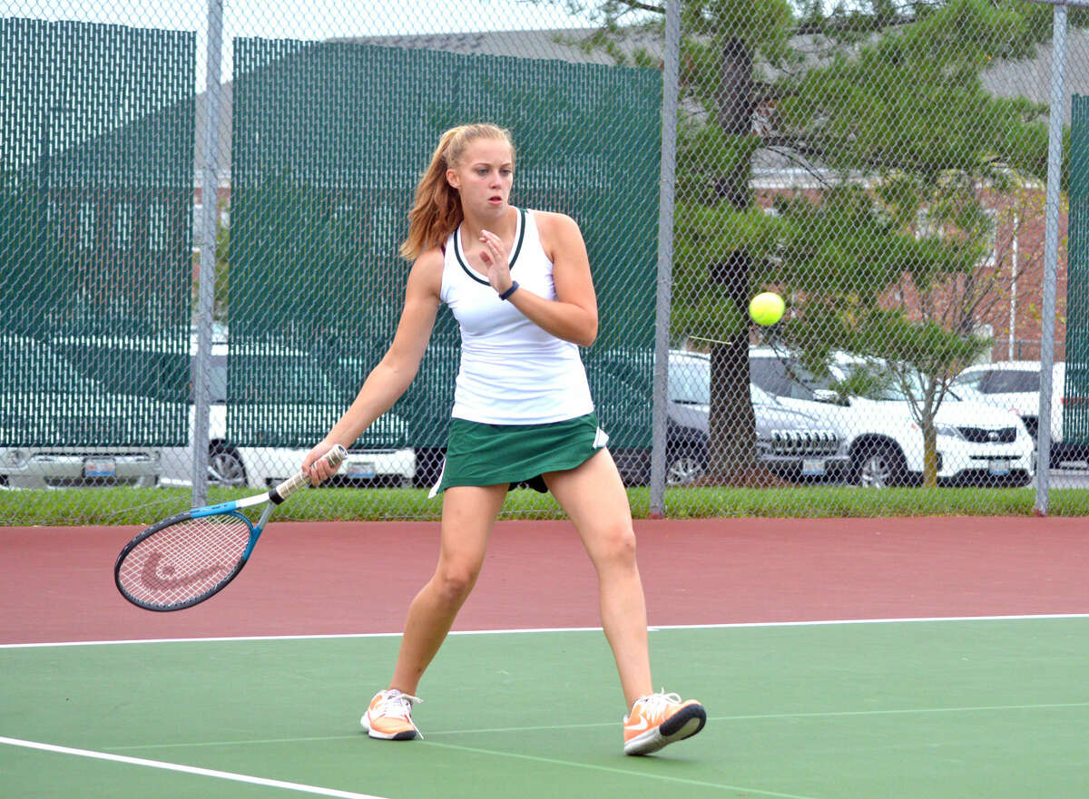 Metro-East Lutheran senior Cierra Frields hits a forehand during her No. 2 singles match against Edwardsville junior varsity player Alyssa Wilson.