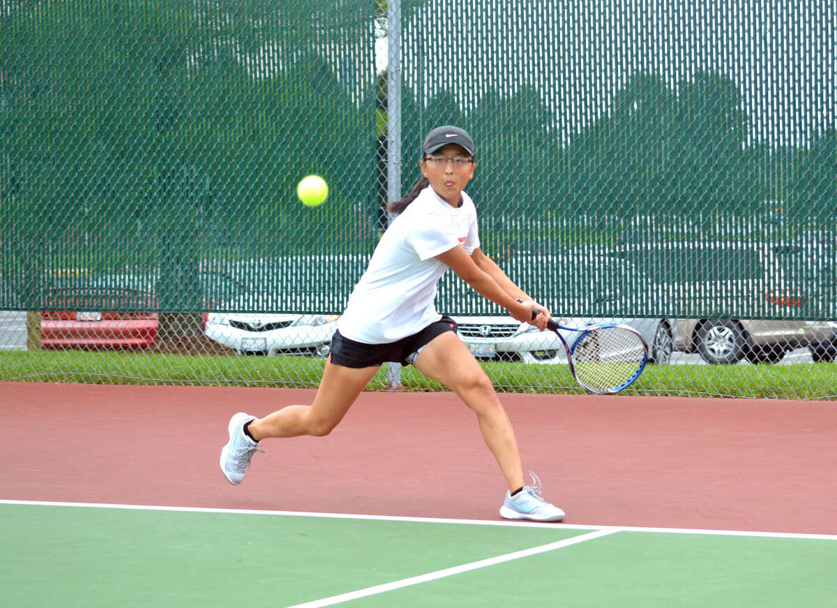 Edwardsville junior varsity player Kilauren McMahon hits a backhand during her No. 1 singles match against Metro-East Lutheran's Heather Moore-Malec.