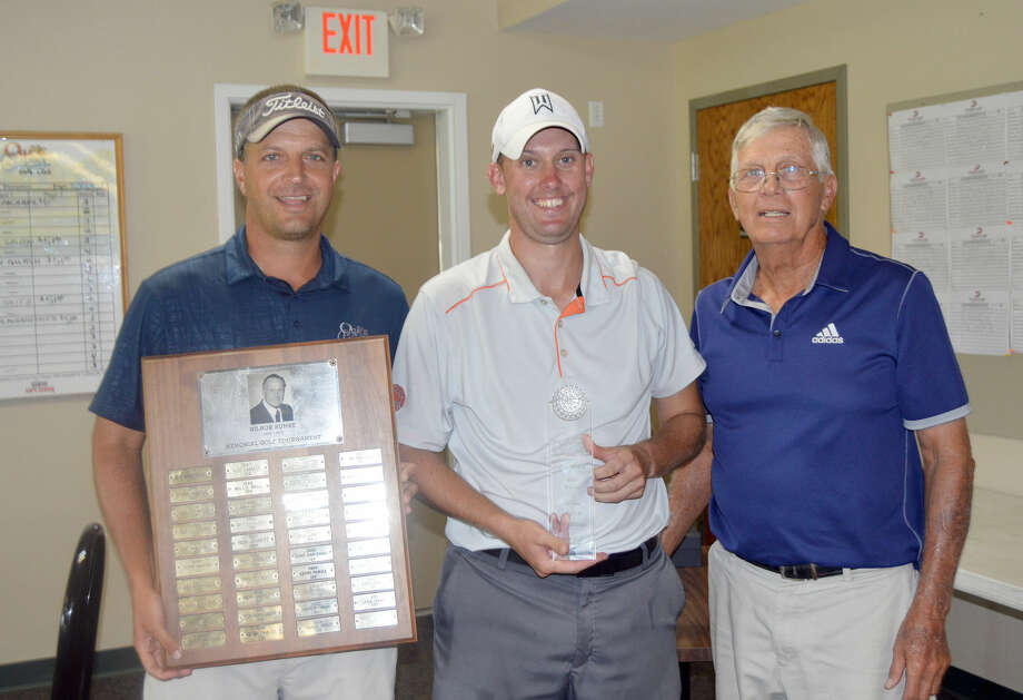 Vice President of Oak Brook Golf Club Mike Suhre, left, and Larry Suhre, right, congratulate Corey Choate after he won the 40th Annual Wilbur Suhre Memorial tournament at Oak Brook Golf Club on Sunday in Edwardsville.