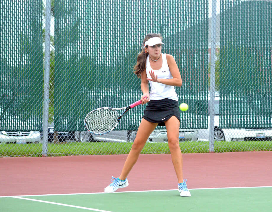 Edwardsville junior varsity player Alyssa Wilson hits a forehand during her No. 2 singles match against Metro-East Lutheran's Cierra Frields.