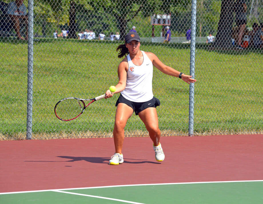 Edwardsville's Natalie Karibian makes a forehand return on Saturday during her No. 1 singles match against Normal Community at the Southern Illinois Duals.