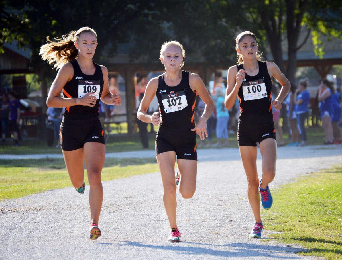 Edwardsville runners Melissa Spencer, left, Abby Schrobilgen, center, and Abby Korak lead the girls' race near the second-mile marker.