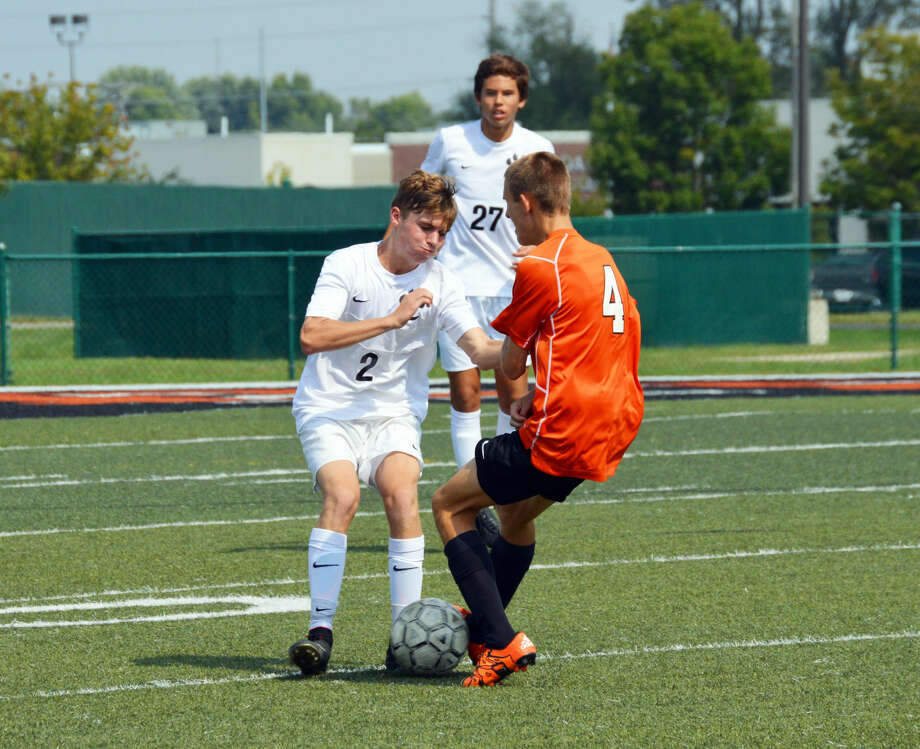 Edwardsville defender Blake Conway, left, makes a play on Normal Community's Michael Reibling early in the first half Saturday at the District 7 Sports Complex.
