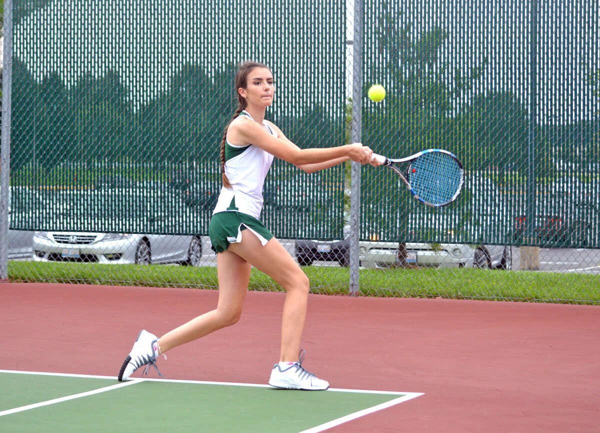 Metro-East Lutheran senior Heather Moore-Malec returns a shot during her No. 1 singles match on Tuesday against Edwardsville junior varsity player Kilauren McMahon.