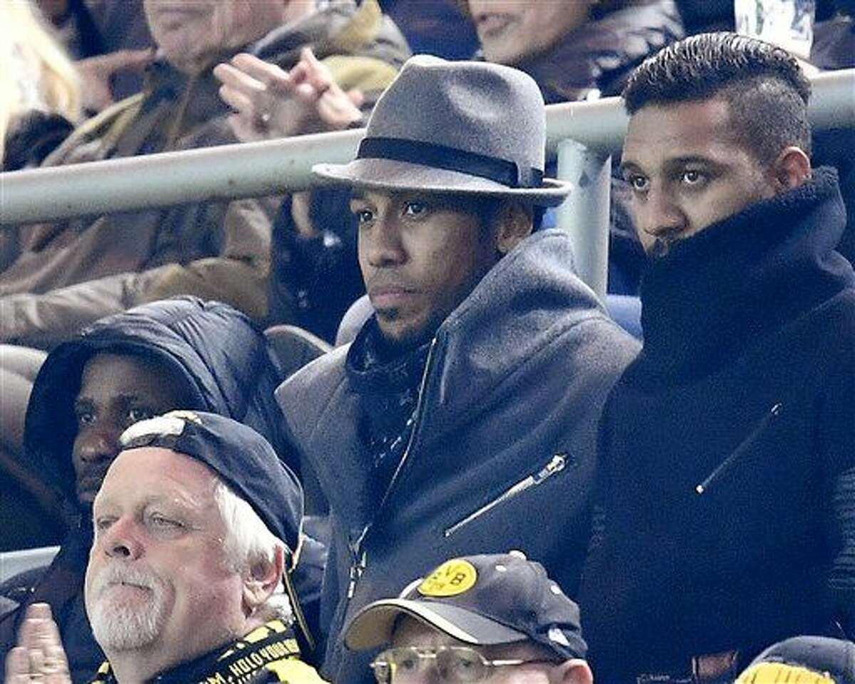 Dortmund's Pierre-Emerick Aubameyang, center watches from the tribune during the Champions League group F soccer match between Borussia Dortmund and Sporting CP in Dortmund, Germany, Wednesday, Nov. 2, 2016. (AP Photo/Martin Meissner)