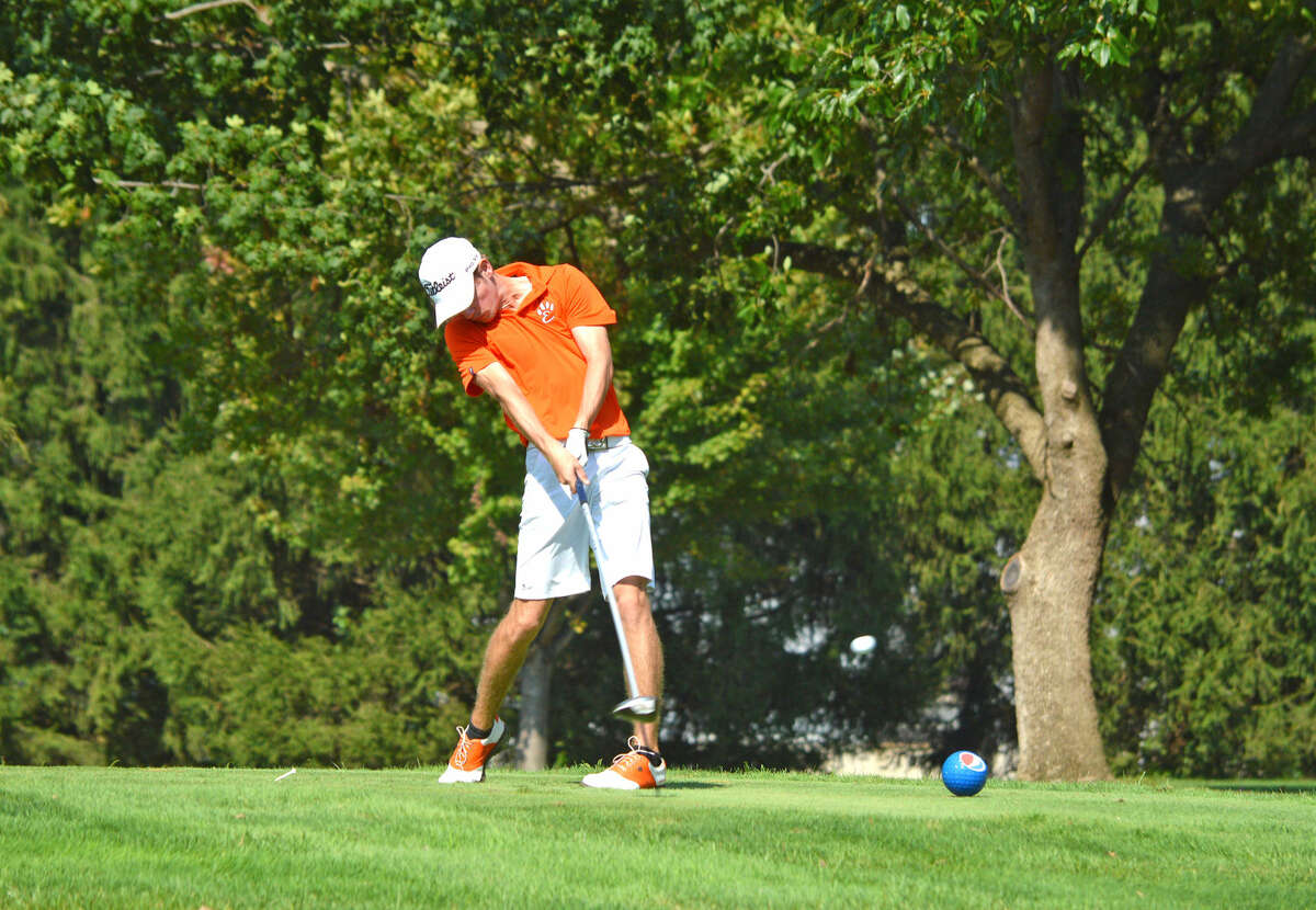 Edwardsville junior Tanner White hits a tee shot on hole No. 14 at Westview Golf Course during Tuesday's Class 3A Quincy Regional.