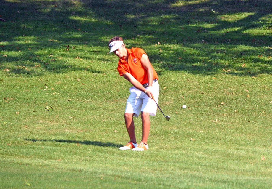 EHS junior Ben Tyrrell hits a chip shot on hole No. 18.