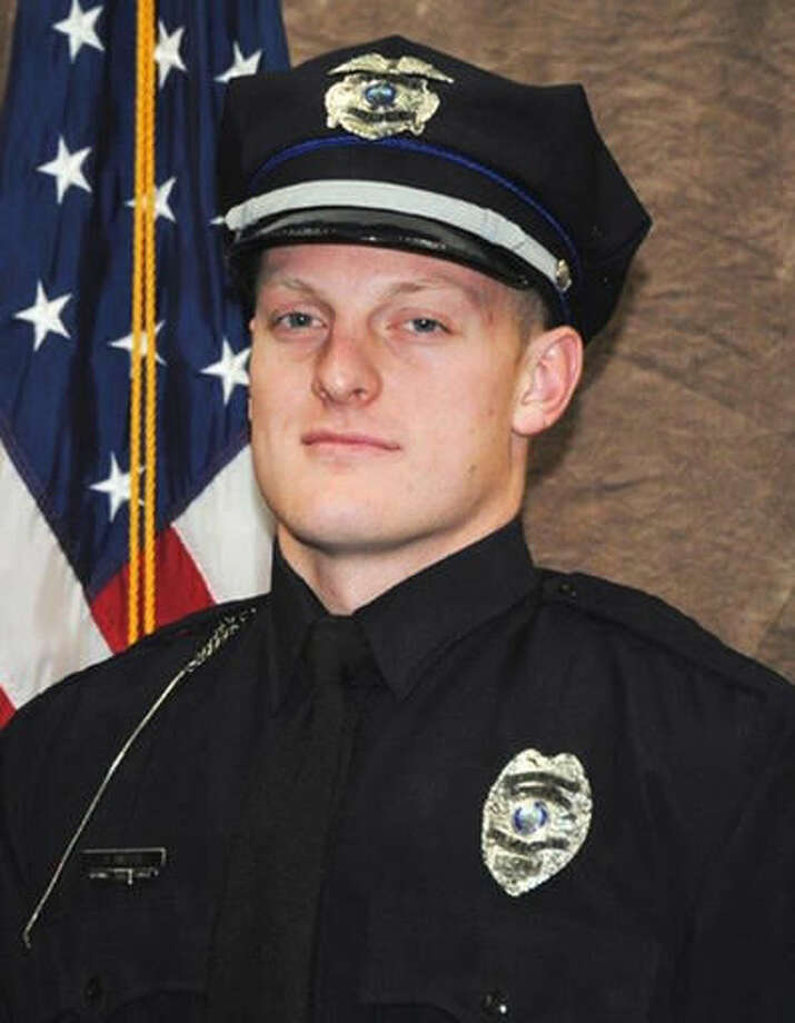 This undated photo provided by the Des Moines Police Department shows Urbandale, Iowa police Officer Justin Martin, who is one of two Des Moines area police officers shot to death early Wednesday, Nov. 2, 2016. Police say Scott Michael Greene, of Urbandale, the man suspected in the killings surrendered Wednesday to a state Department of Natural Resources officer. (Des Moines Police Department via AP)
