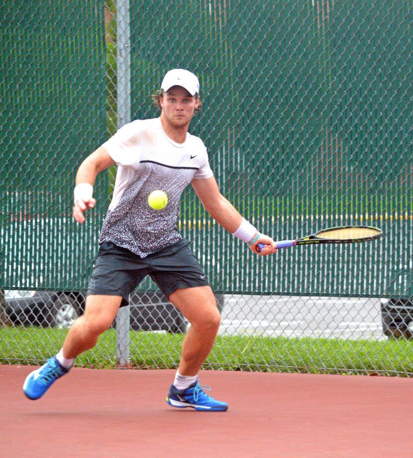 Daniel Hobart returns a shot during his singles match against Jesus Bandres.