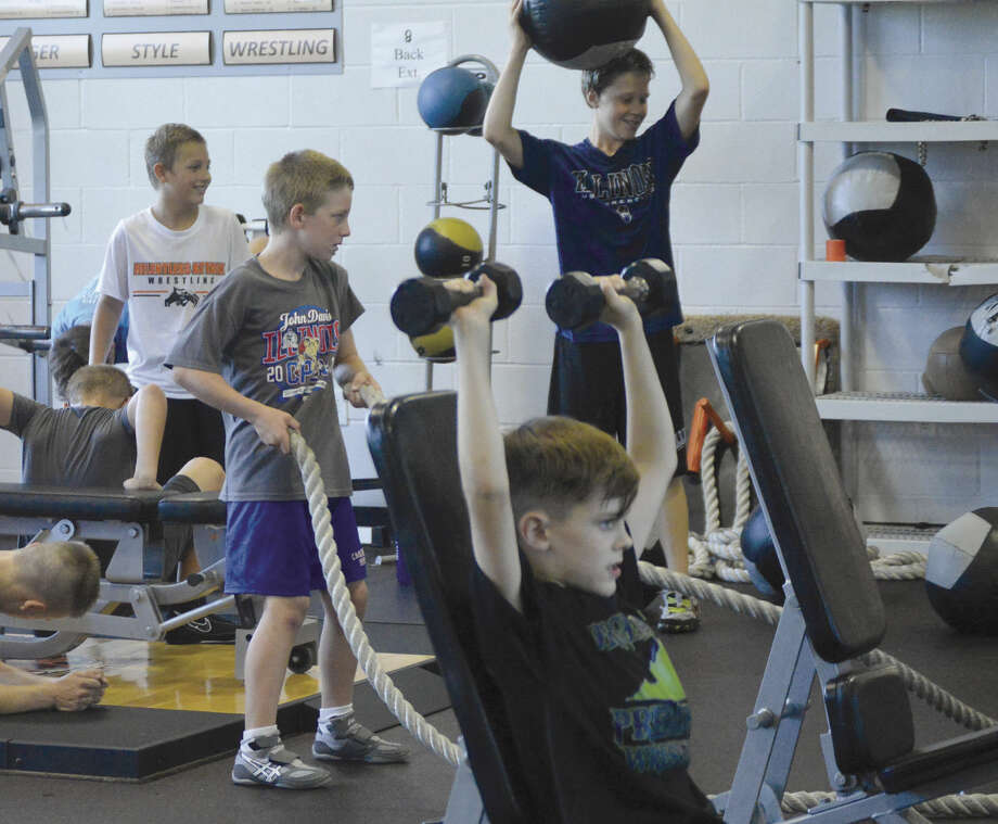 EWC campers hit the weights and learn proper techniques for building muscle.