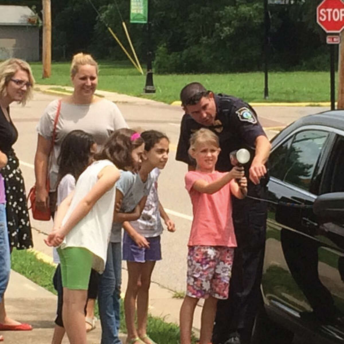 Glen Carbon Police Lt. Wayne White shows a child how to operate a radar gun. The Glen Carbon Police were at the Centennial Library teaching students how vital the role science, technology, engineering and math, STEM, are to modern day law enforcement.