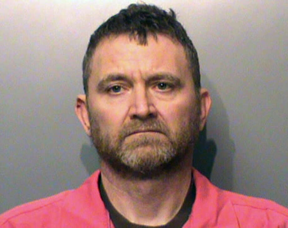This Nov. 3, 2016 photo provided by the Polk County Sheriff's Office in Des Moines, Iowa, shows Scott Michael Greene, of Urbandale, Iowa. Greene was arrested earlier in the day and charged with first-degree murder in the deaths of Des Moines Sgt. Anthony Beminio and Urbandale officer Justin Martin. Police say Greene fired upon the officers while they were sitting in their patrol cars in separate attacks early Wednesday. (Polk County Sheriff's Office via AP)