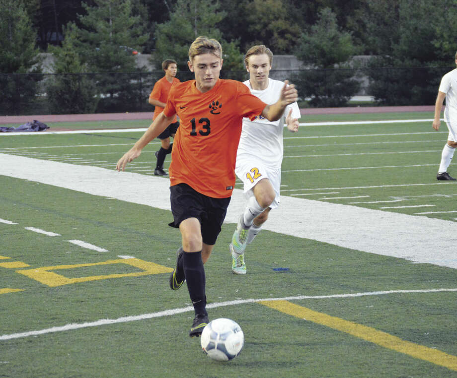 Edwardsville senior defender Sean Swanson races the ball up the field against CBC in first-half action in St. Louis.