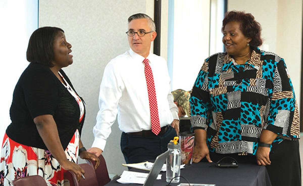 Talking before SIUE's third Black Lives Matter Conference are (left to right): Jessica Harris, PhD, and Bryan Jack, PhD, assistant and associate professors, respectively, of historical studies in SIUE's College of Arts and Sciences (CAS); and Venessa Brown, PhD, associate chancellor for Diversity and Inclusion.