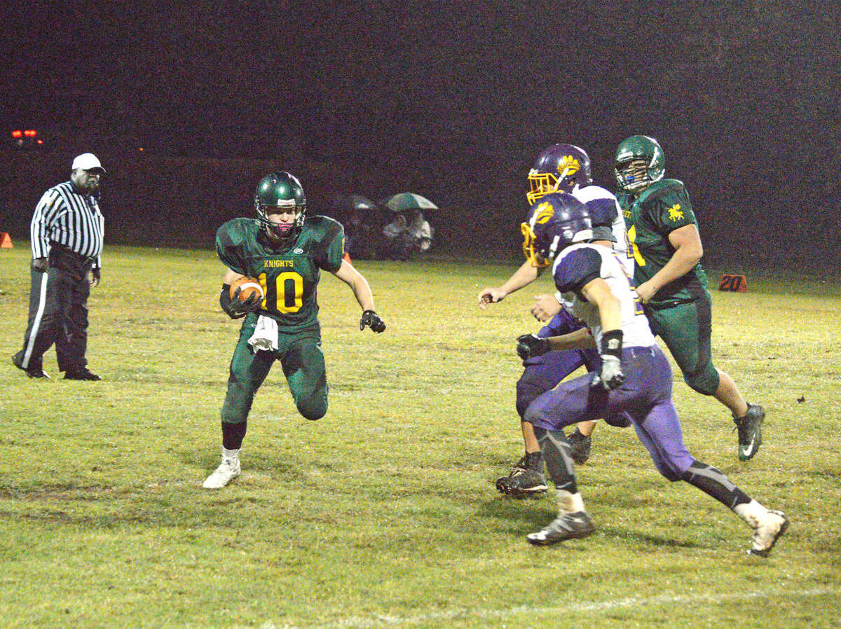 Metro-East Lutheran's Zachary Bozarth, left, goes outside to try to pick up some yardage during last Friday's Homecoming game against Mount Olive at MELHS.