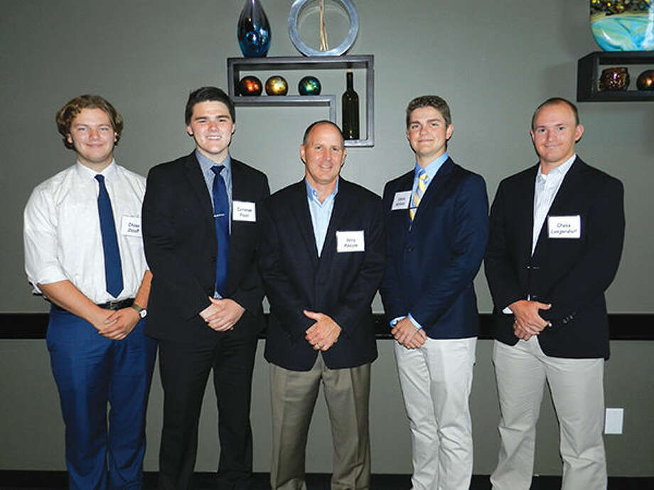 Wood River Refinery Manager Jerry Knoyle congratulates the Phillips 66 Dependent Scholarship recipients. From left are: Chase Zezoff, Cameron Foust,  Knoyle, Shane Nichols, and Chase Langendorf.