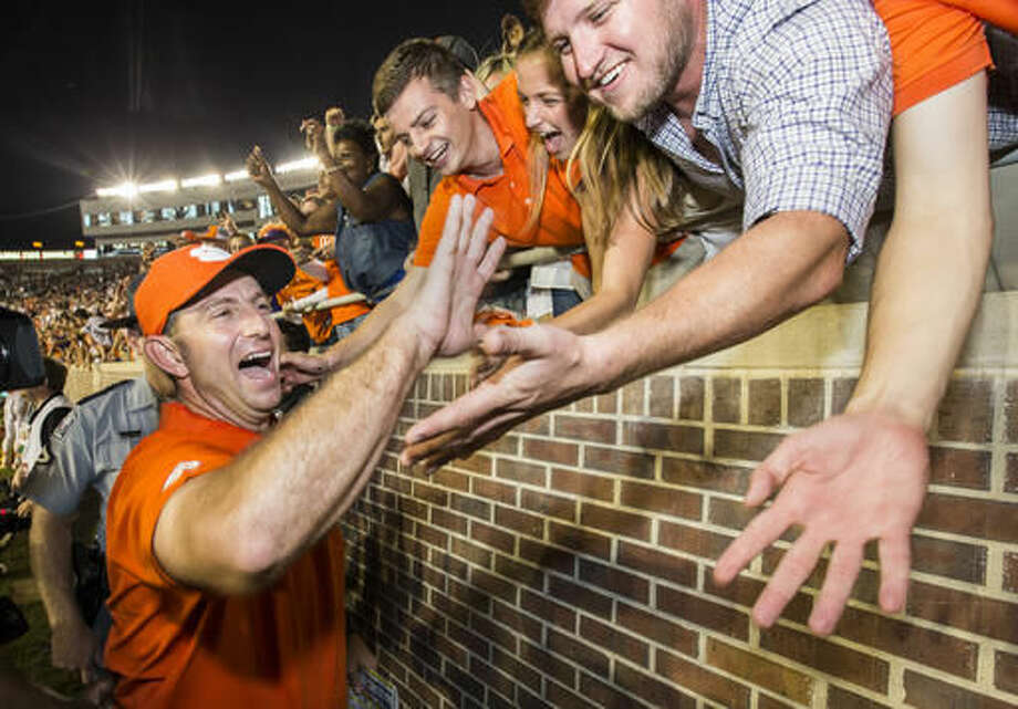 Clemson coach Dabo Swinney celebrates the team's 37-34 win over Florida State in an NCAA college football game in Tallahassee, Fla., Saturday, Oct. 29, 2016. (AP Photo/Mark Wallheiser)