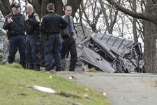 Members of the Connecticut State Police Collision Analysis and Reconstruction Squad (CARS) investigate a rollover crash on Mountainville Road on Thursday. An off-duty city police officer working a private job identified and chased a stolen car in his private vehicle Thursday morning, ending in a high-speed rollover crash with life-threatening injuries to two people. December 1, 2016, in Danbury, Conn.