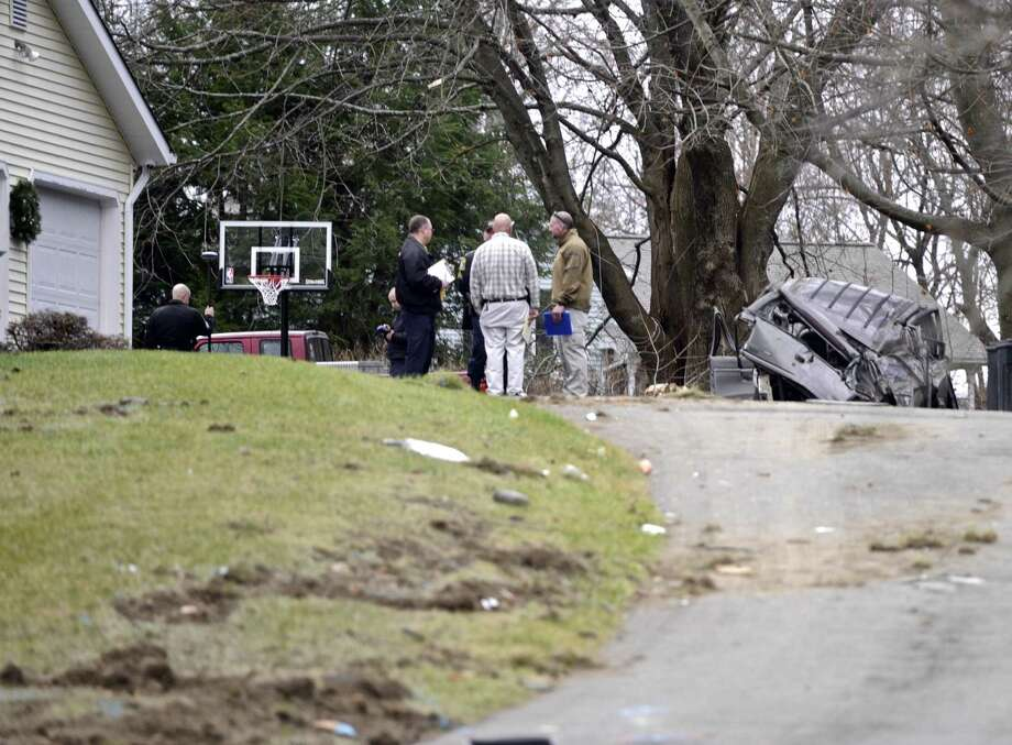 Members of the State Police Collision Analysis and Reconstruction Squad investigate a rollover crash on Mountainville Road in Danbury on Thursday. Photo: H John Voorhees III / Hearst Connecticut Media / The News-Times