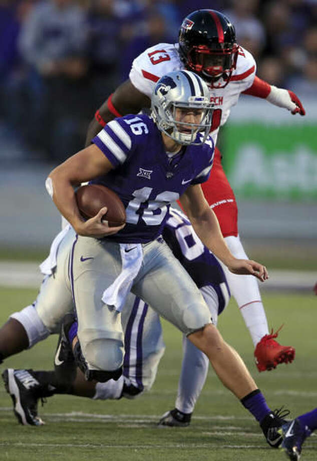 Kansas State quarterback Jesse Ertz (16) gains yards while chased by Texas Tech defensive lineman Kolin Hill (13) during the first half of an NCAA college football game in Manhattan, Kan., Saturday, Oct. 8, 2016. (AP Photo/Orlin Wagner)