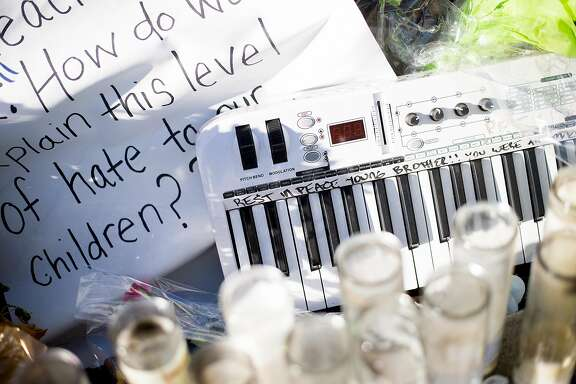 Candles and a keyboard rest at a makeshift memorial for murder victim William Sims on Thursday, Dec. 1, 2016, in El Sobrante, Calif. Investigators said Sims, a 28-year-old African American musician, was targeted because of his race.