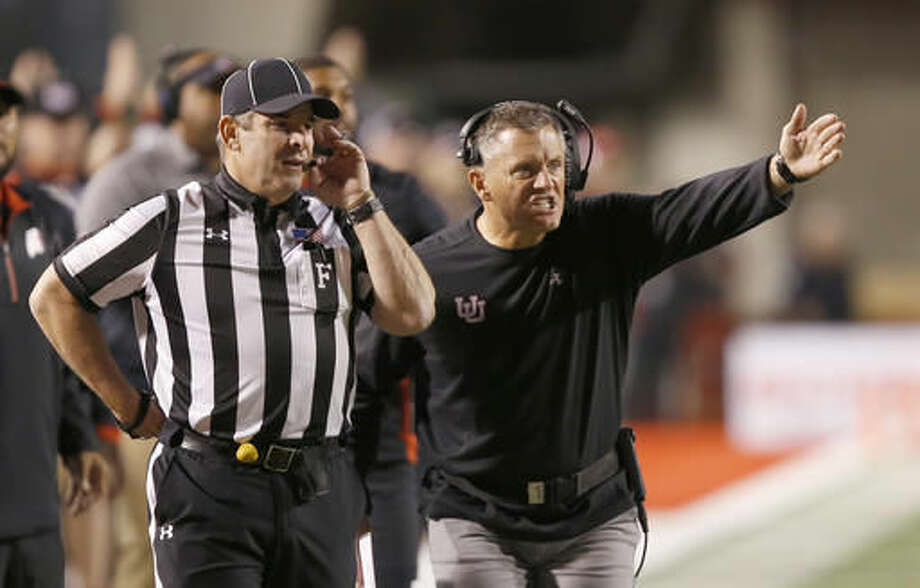Utah coach Kyle Whittingham questions an official during the first half of an NCAA college football game against Arizona, Saturday, Oct. 8, 2016, in Salt Lake City. (AP Photo/George Frey)