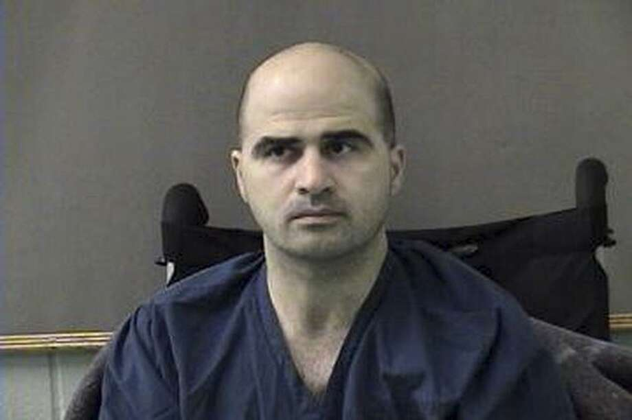 In this photo released by the Bell County Sheriffs Department, U.S. Major Nidal Hasan is shown after being moved from Brooke Army Medical Center in San Antonio to Bell County Jail in Belton, Texas on Friday April 9, 2010. Hasan had been at the military hospital since shortly after a Nov. 5 shooting spree at Fort Hood which left him paralyzed. He is charged with 13 counts of premeditated murder and 32 counts of attempted premeditated murder. (AP Photo/Bell County Sheriffs Department) Photo: AP / Bell Couty Sheriffs Department