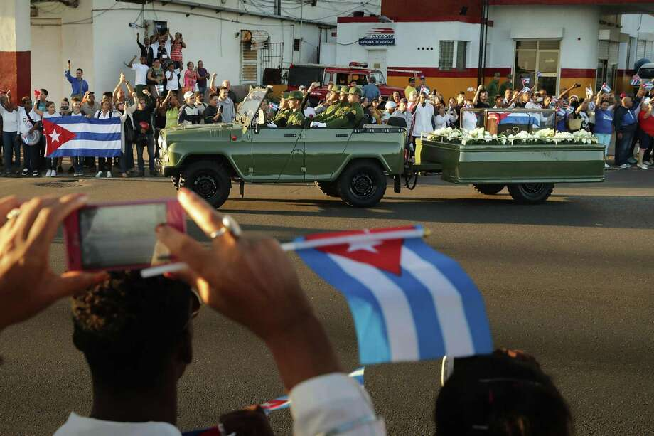 A military truck pulls a trailer with the flag-draped chest that holds the remains of former President Fidel Castro as Cubans line the Malecon boulevard to pay their respects Wednesday. Donald Trump should understand that Castro loved the embargo more than anyone else. Photo: Chip Somodevilla /Getty Images / 2016 Getty Images