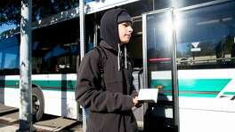 Mataio Tupuola-Mair exits a bus while heading to work on Thursday, Dec. 1, 2016, in El Sobrante, Calif.